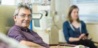 Man receiving colon cancer treatment