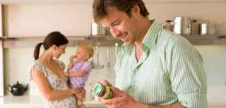 A father reading a baby food label