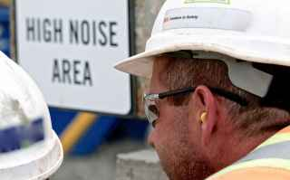 Man wearing ear protection