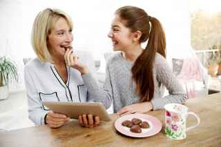 Mom and daughter eating chocolate