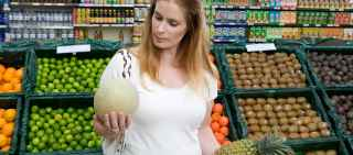 woman in grocery looking at food
